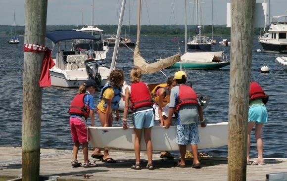 Kids around a boat